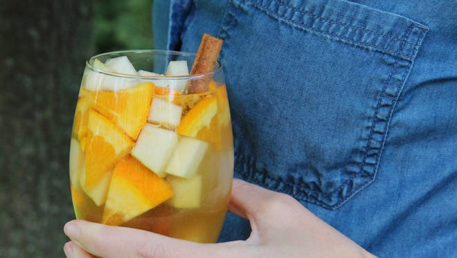 Fall Sangria gets spicy autumn notes from maple cinnamon simple syrup.