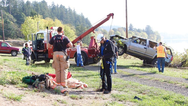 A car is pulled from Willamette River west of Salem, just next to the Rock-N-Rodgers on 4250 Salem Dallas Highway NW on Thursday, Sept. 29 at about 10 a.m.