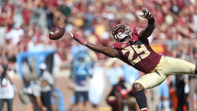 FSU's Nate Andrews comes up just short trying to intercept a pass against UNC during their game at Doak Campbell Stadium on Saturday.