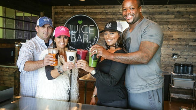 Left to right, Juice Bar Co-Owners, Matt Brereton, his wife and former Colts Cheerleader Dee Brereton, Cristin Langford, and her husband, Colts Defensive End, Kendall Langford, have just opened the the new Juice Bar, located at 1420 Main Street, Carmel, IN 46032.