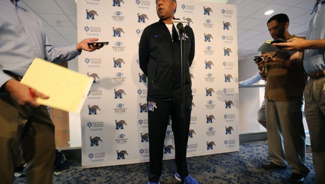 University of Memphis basketball coach Tubby Smith talks with the media before the start of Wednesday's opening practice at the Finch Center.