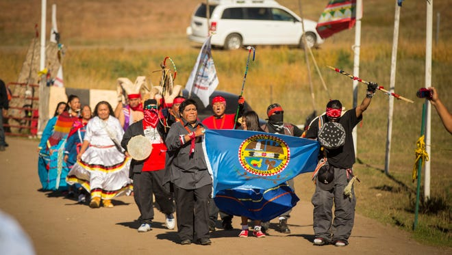 Representatives of the Havasupai Tribe from the Havasupai Indian Reservation in the Grand Canyon enter the Oceti Sakowin Camp near Standing Rock reservation Thursday, Sept. 29, 2016, near Cannon Ball, N.D. The Dakota Access pipeline passes less than two miles from the camp and will go under Lake Oahe and the Missouri River.