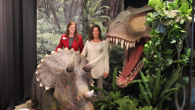 Get your picture taken with two dinosaurs at the Jurassics Journey exhibit at Discovery Park of America.