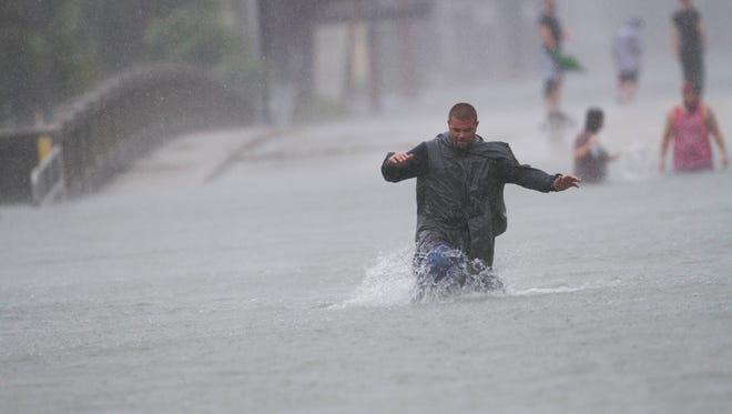 St. Augustine resident, Nick Lomasny checks out the flooding  from Hurricane Matthew on Friday.   Matthew skirted the historic town causing wide spread flooding.