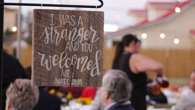 Juanita Shaw said the goal of Tuesday night's inaugural Feast in the Field event was to welcome community servants to the table so they could share their stories.
