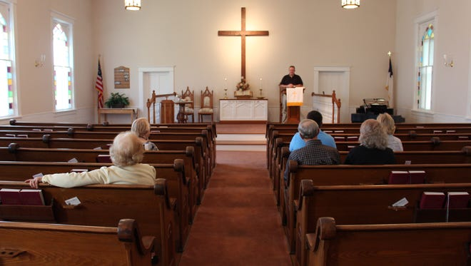 Members of First Congregational Church listen to Rev. Jeff Slater's sermon about John 3:16 during Sunday service Sunday, Oct. 9, 2016. The Lexington church has struggled for the last several years to attract younger members, so it is closing after its final service Oct. 23.