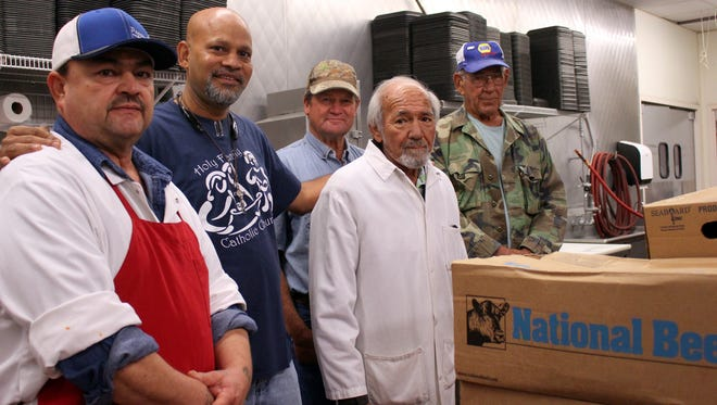 Preparation for the 88th annual Klobase Festival in Deming begins with the meats at Peppers Supermarket. From left are meat cutter Gary Baca, Fr. Ron Machado Frank Hervol, meat department manager Manny Martinez and Nick Hervol.