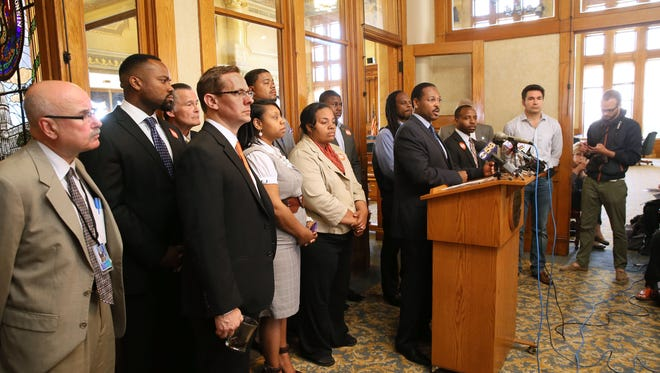 Milwaukee Common Council President Ashanti Hamilton and other alderman along wtih community leaders, speak about public safety during a press conference.