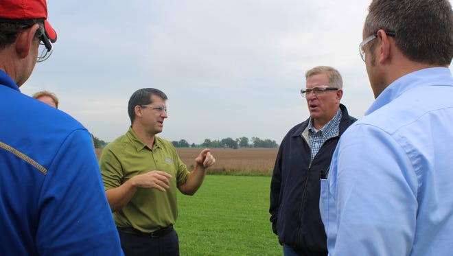 Fox River Valley Ethanol President and General Manager Neal Kemmet (left) answers a question from Wisconsin Deputy Ag Secretary Jeff Lyon during a Wisconsin Agri-Business Association Tour at the ethanol production facility last fall. Lyon has been tapped as the interim ag secretary.