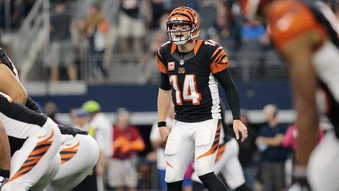 Bengals quarterback Andy Dalton calls out a play in the second quarter of Sunday's loss to Dallas.