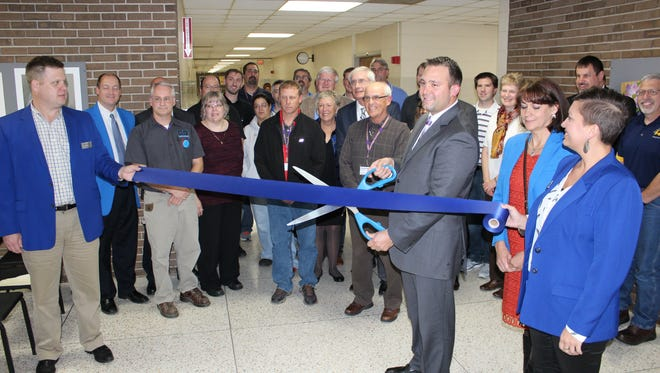 Sheboygan Falls High School principal Luke Goral leads the ribbon cutting ceremony for the new tech center on Thursday, Oct. 13.