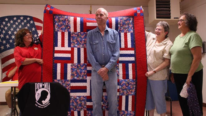 Pictured, from left, are American Legion Auxiliary, Unit 4, members William Franklin, Alyce Brown and Marilyn Goble. They presented a hand-made Quilt of Valor on Thursday to Franklin at the American Legion Bataan Post 4, 619 W. Spruce St.. Brown and Goble as members of the Deming Quilting Bees. Franklin's served in the U.S. Navy.