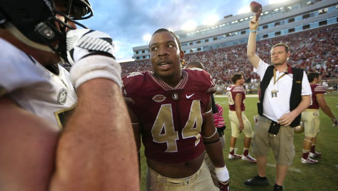 FSU's DeMarcus Walker talks to players from the other team after their 17-6 homecoming win against Wake Forest at Doak Campbell Stadium on Saturday.