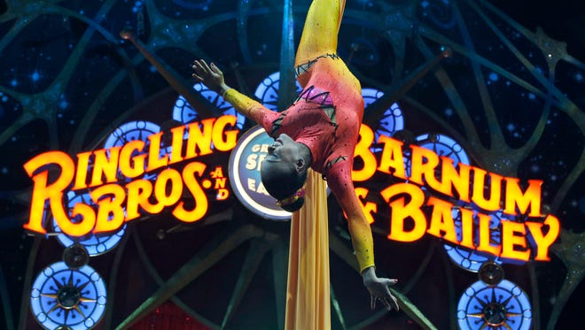 A performer hangs upside down during a pre-show performance of the Ringling Bros. and Barnum & Bailey Circus on March 19, 2015, in Washington.