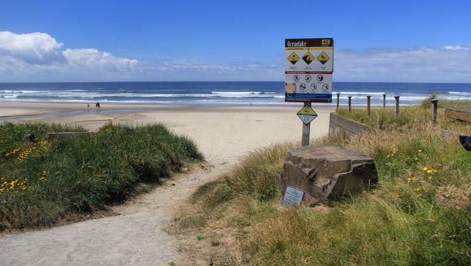 This sign near a beach access in Lincoln City advises visitors of beach safety concerns.