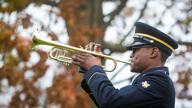 Spc. Neil Davis, of Dover, with the 287th Army Band, plays at a ceremony in New Castle on Sept. 9, 2015. Wilmington is recognizing the holiday this month.