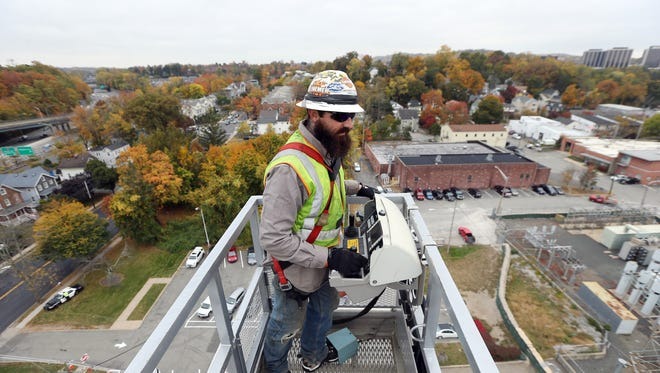 Lineman Mike Szymanski Jr. of North Hanover operates a Bronto Skylift Aerial Unit 150 feet in the air over Morristown as JCP&L hosted a Careers in Utilities event program including equipment and skills demonstrations. October 20, 2016, Morristown, NJ.