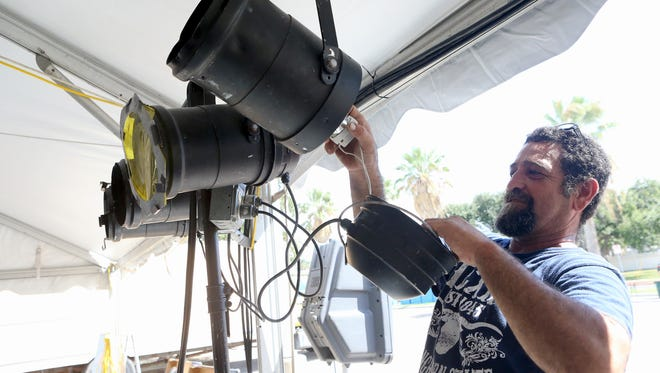 Anselmo Escobar adjusts lights as he prepares for the Texas Jazz Festival on Thursday, Oct. 20, 2016, at Heritage Park in Corpus Christi.