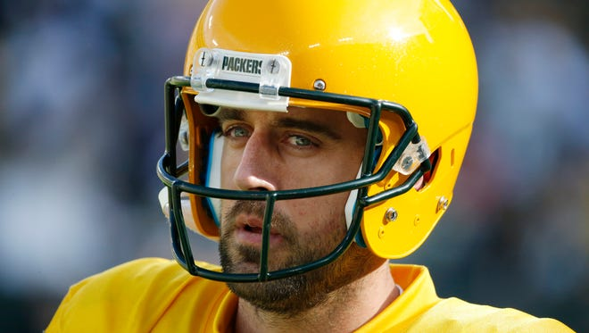 Green Bay Packers' Aaron Rodgers warms up before an NFL football game against the Dallas Cowboys Sunday, Oct. 16, 2016, in Green Bay, Wis.
