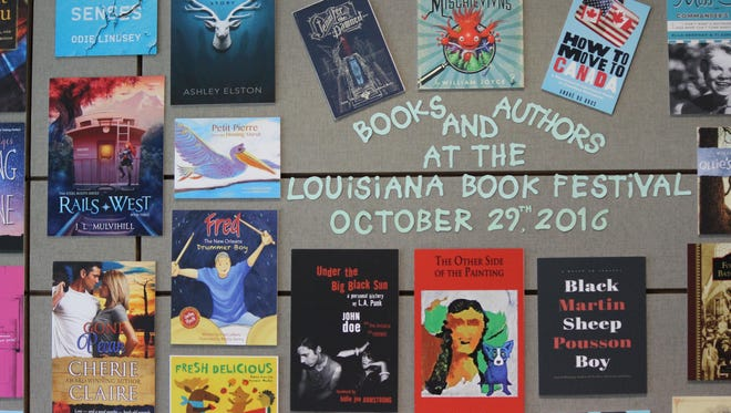 The Louisiana Book Festival cover wall features a number of authors.