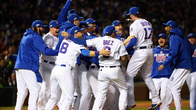Cubs players celebrate the win.