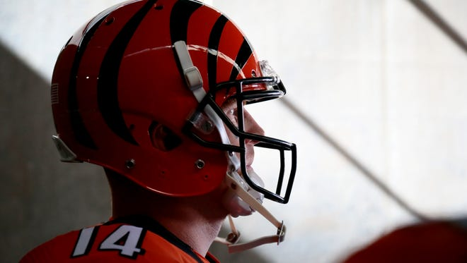 Cincinnati Bengals quarterback Andy Dalton (14) waits to take the field from the tunnel in the first quarter of the NFL Week 7 game between the Cincinnati Bengals and the Cleveland Browns at Paul Brown Stadium in Cincinnati on Sunday, Oct. 23, 2016. At halftime the Bengals led the Browns 21-10.