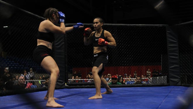 Stacey Sigala, right, trades punches with Roxanne Ceasear during Saturday's Havoc at Hobbs fight card.