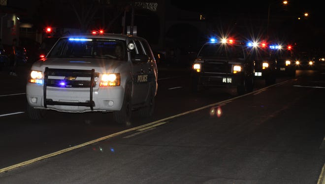 Law enforcement officers from all branches joined in Monday night's motor escort of Sheriff''s Lieutenant Richard Cowles return to Deming.