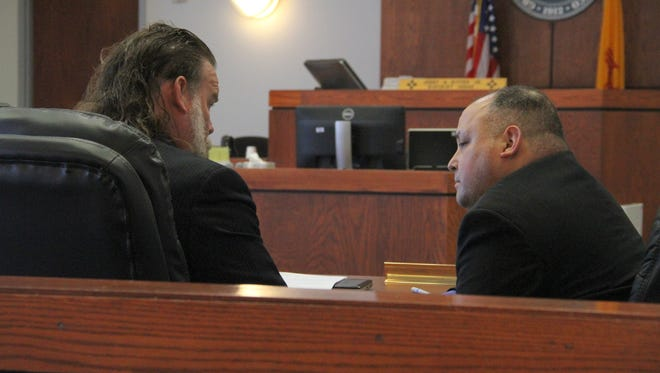Former Alamogordo police officer Warren D. Whittington (R) talks to his defense attorney Todd Holmes during Whittington's trial in 12th Judicial District Court.