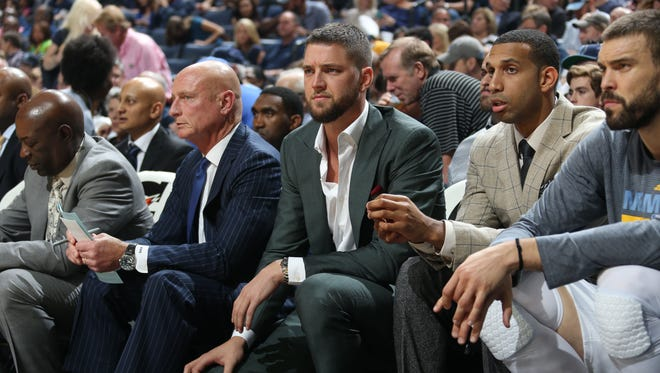 Memphis Grizzlies Chandler Parsons, center, on the bench against the Minnesota Timberwolves.