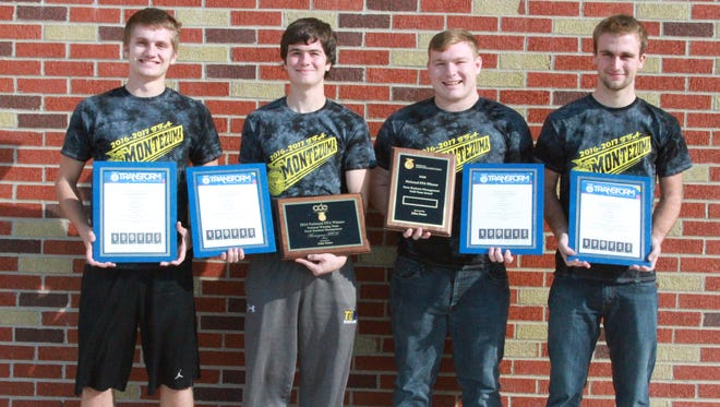 The Montezuma High School FFA Farm Business Management Team captured a national championship at the 89th National FFA Convention and Expo in Indianapolis. The team, including, from left, Shane Helm, Tyler Meyer, Hunter Foubert and Grand Johnson, won the natonal championship - the fifth time the Montezuma FFA has had a national championship in the 46-year event, which ties a national record.