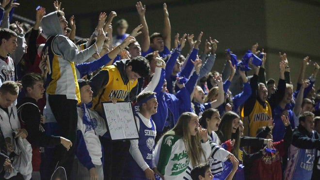 Hamilton Southeastern fans go crazy in the stands, Friday October 28th, 2016. The Carmel Grayhounds took on the Hamilton Southeastern Royals, at Hamilton Southeastern High School.