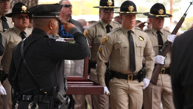 Members of various law enforcement agencies watch as Luna County Sheriff's Deputies escort Lt. Cowles during his memorial services. Lawmen for around the state were present to show final respects to the fallen Lieutenant.