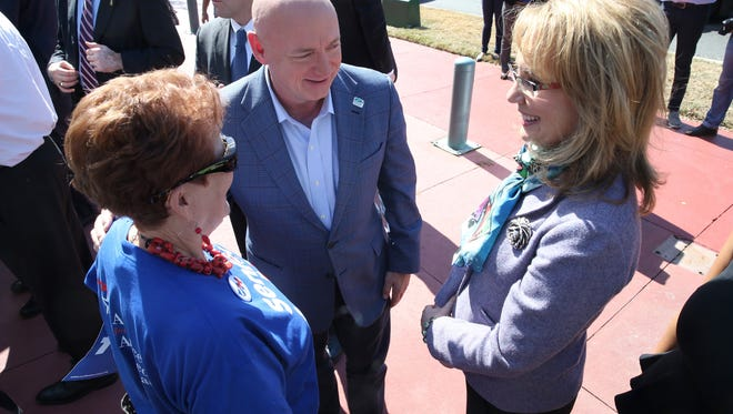 Former Arizona Rep. Gabrielle Giffords, right and her husband, former astronaut Mark Kelly talks with Barbara DeVane at the Leon County Courthouse. Giffords and Kelly are promoting stricter gun laws and the candidates who support them. They were in Tallahassee with Vice Presidential Candidate Tim Kaine