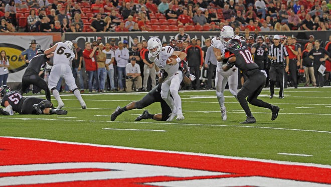 Quarterback Will Collins (9) scrambles from the pocket in ULM's 51-10 loss to Arkansas State.