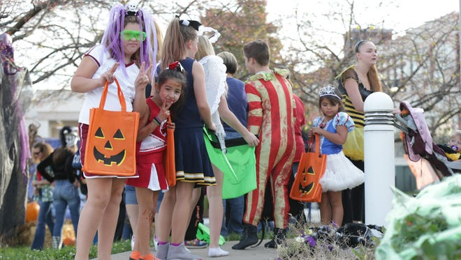 Trick-or-treaters wait in line for candy during the Southeast District Roll Call, 1150 Shelby St., Monday October 31st, 2016.