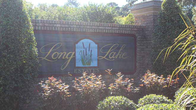 The signage for Long Lake Estates that marks the entrance into the subdivision. The area may see an expansion of 50 plots, pending MPC review.