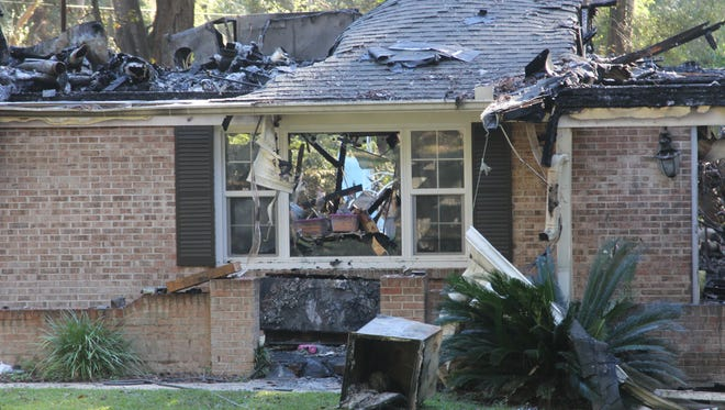 A Sunday morning fire destroyed this Ox Bottom Road home. The blaze is believed to be accidental.