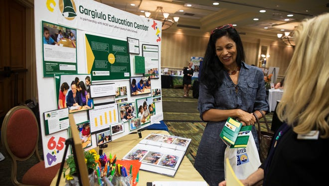 Rocio Elisa laughs while talking with Bobbie Mayhood, of the Gargiulo Education Center, during the Get Involved Collier! 2016 Volunteer Expo at the Hilton Hotel in Naples on Wednesday, Nov. 2, 2016. Over 50 local nonprofit organizations in Collier County that have volunteer needs attended the event and networked with volunteers.