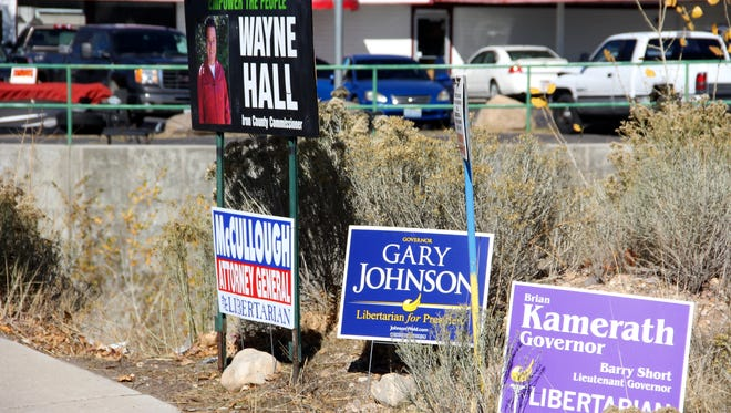 Libertarian candidate signs are seen on Main Street on Wednesday, Nov. 2, 2016.