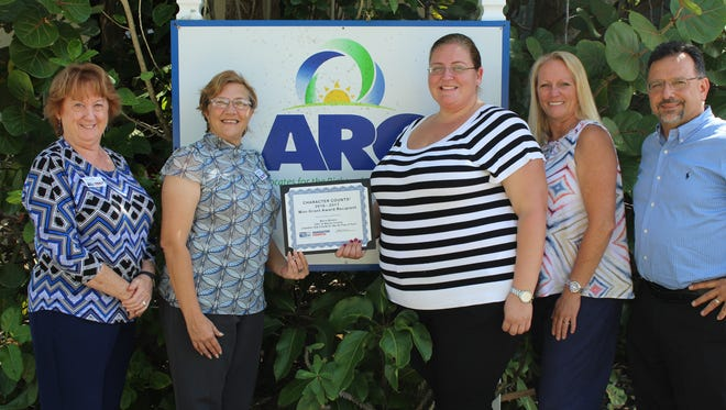 Holly Laiben, Cara Gabrielson, Maria Botero, Danielle Sexon-Wills and Keith Muniz celebrate Maria's CHARACTER COUNTS! Award at ARC of Martin County offices.