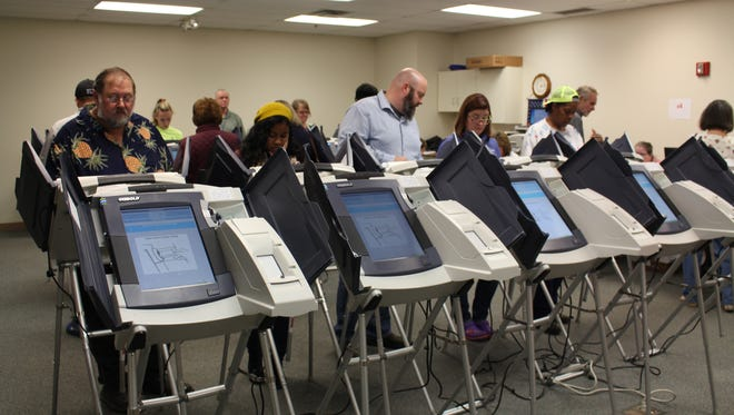 Richland County residents cast their ballots during early voting Sunday, Nov. 6, 2016. Voters waited in a 15-minute line to vote Sunday ahead of Tuesday's general election.