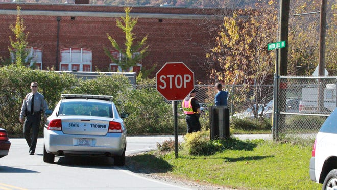 Law enforcement officials closed off a portion of Old U.S. Highway 70 when Buncombe Community School received a bomb threat by phone.