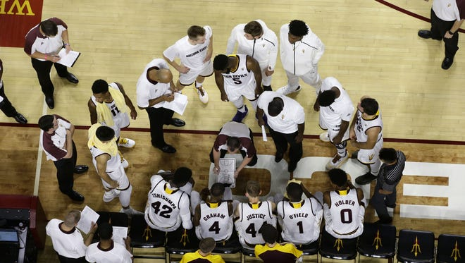 ASU head coach Bobby Hurley huddles with his players during a timeout against UC Santa Cruz in the first half on Nov. 3, 2016 in Tempe, Ariz.