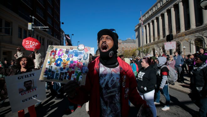 Protesters gather outside the Hamilton County Courthouse after the trial of former University of Cincinnati police officer Ray Tensing was declared a mistrial, Saturday, Nov. 12, 2016, Cincinnati.