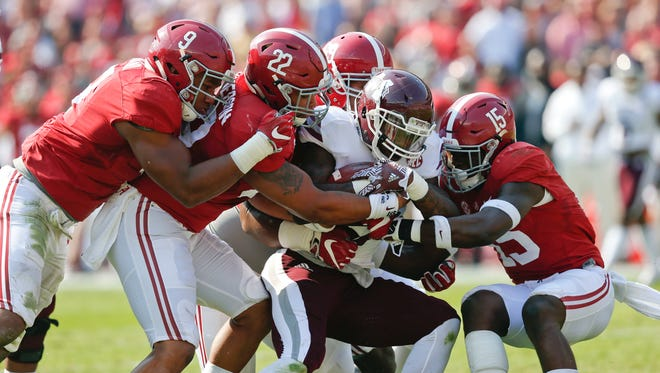 Mississippi State running back Aeris Williams, center, is tackled by Alabama defenders the first half Saturday. The Bulldogs were held to 274 total yards in a 51-3 loss.