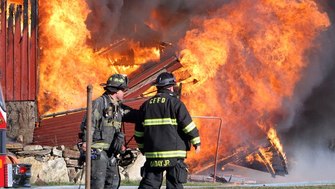Croton Falls firefighters, with help from several neighboring Westchester and Putnam departments, battle a fast-moving fire Sunday afternoon that destroyed a barn and garage on Hardscrabble Road in North Salem.