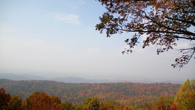 Smoke drifts over over the Smoky Mountains and Blount County from North Carolina Monday.