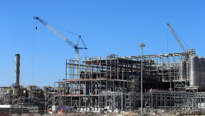 Construction continues at the M&G Resins USA plant at Nueces Bay. The Italian-owned facility will be laying off 100 employees until Thanksgiving week, according to a report by the Texas Workforce Commission.