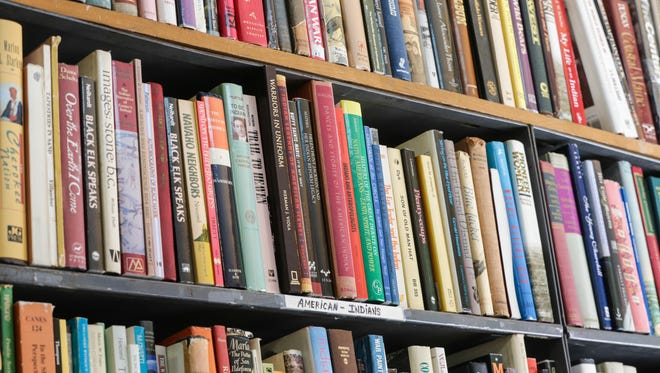 Indianapolis' oldest bookstore, Books Unlimited, 2629 Shelby Street, features a The American Indiana section, Tuesday, Nov. 15, 2016.